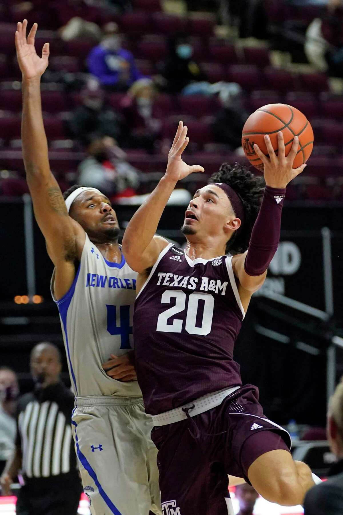 Texas A&M guard Andre Gordon (20) shoots over New Orleans forward Jahmel Myers (4) during the second half of an NCAA college basketball game Sunday, Nov. 29, 2020, in College Station, Texas. (AP Photo/Sam Craft)