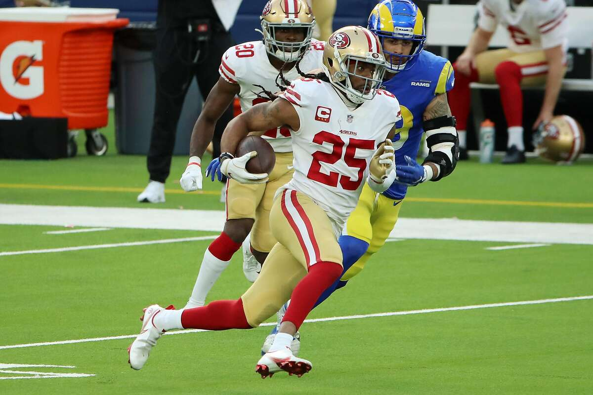 Cornerback Richard Sherman returns an intercepted pass in the first quarter of the 49ers win over the Rams in Inglewood.