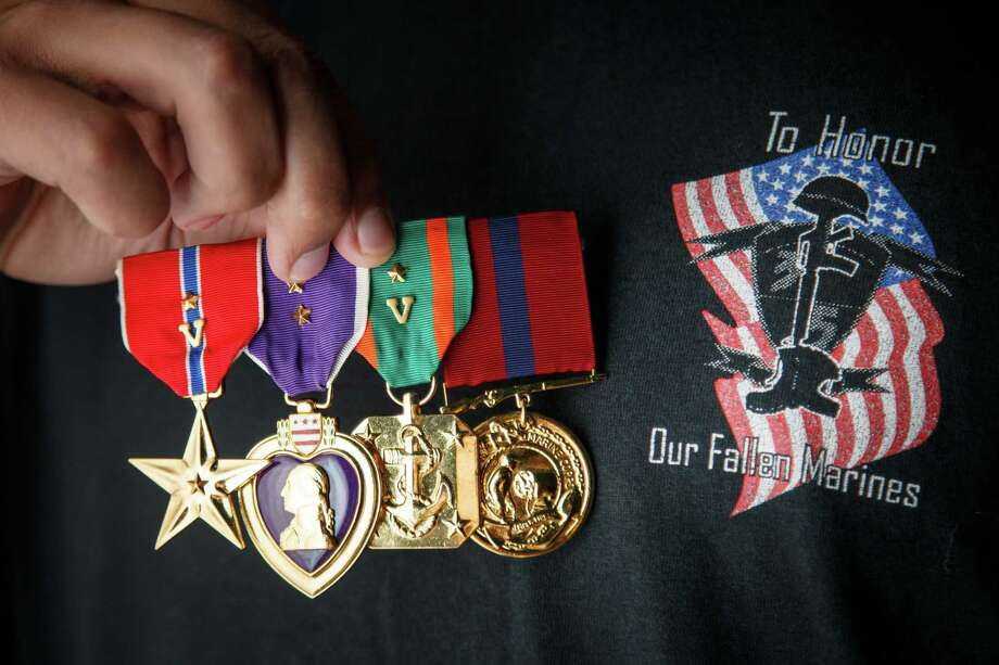 Retired Marine Sgt. Marty Gonzalez was awarded three Purple Hearts and earned two Bronze Stars during his military service, shown in his yet-to-be-born daughter's bedroom on Jan. 22, 2014, in Houston. Photo: Michael Paulsen, Staff / Houston Chronicle / © 2014 Houston Chronicle