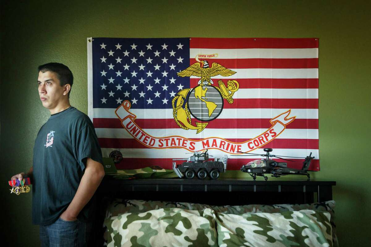 Retired Marine Sgt. Marty Gonzalez was awarded three Purple Hearts and earned two Bronze Stars during his military service, shown in his son's bedroom on Jan. 22, 2014, in Houston. Gonzalez died unexpectedly on Saturday.