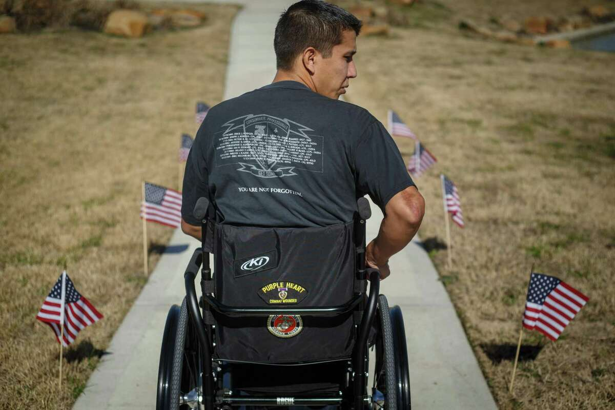 Retired Marine Sgt. Marty Gonzalez was awarded three Purple Hearts and earned two Bronze Stars during his military service, shwon as he goes for a walk outside his home on Jan. 22, 2014, in Houston. Gonzalez died unexpectedly Saturday.