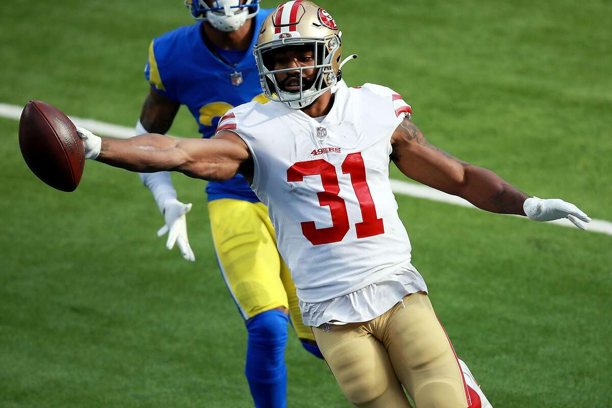 INGLEWOOD, CALIFORNIA - NOVEMBER 29: Raheem Mostert #31 of the San Francisco 49ers celebrates scoring a touchdown during the first quarter against the Los Angeles Rams at SoFi Stadium on November 29, 2020 in Inglewood, California. (Photo by Joe Scarnici/Getty Images)