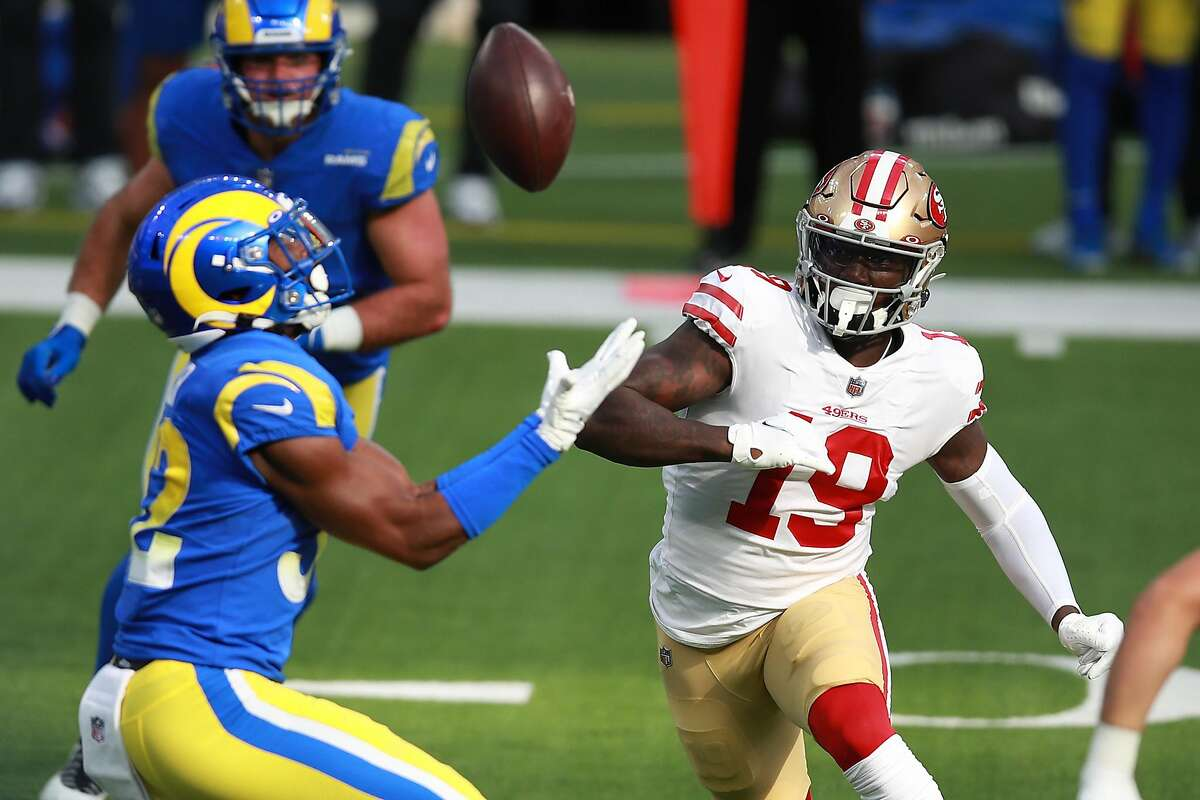 INGLEWOOD, CALIFORNIA - NOVEMBER 29: Deebo Samuel #19 of the San Francisco 49ers watches as Troy Hill #22 of the Los Angeles Rams intercepts a pass during the first quarter at SoFi Stadium on November 29, 2020 in Inglewood, California. (Photo by Joe Scarnici/Getty Images)