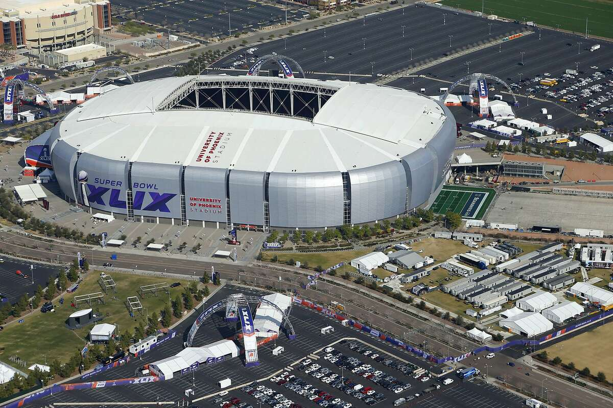 In this aerial photo, the playing field for the NFL Super Bowl XLIX football game is rolled into the University of Phoenix Stadium, Wednesday, Jan. 28, 2015, in Glendale, Ariz. The Super Bowl game between the New England Patriots and the Seattle Seahawks will be played this Sunday.