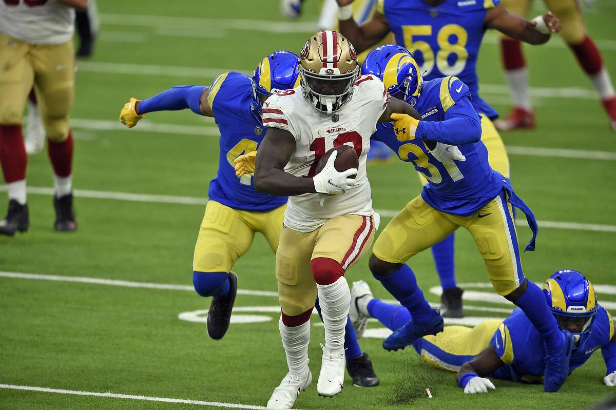 San Francisco 49ers wide receiver Deebo Samuel (19) carries after a catch during the second half of an NFL football game against the Los Angeles Rams Sunday, Nov. 29, 2020, in Inglewood, Calif. (AP Photo/Kelvin Kuo)