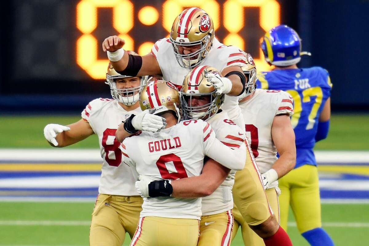 Robbie Gould #9 of the San Francisco 49ers celebrates with teammates after making a game-winning field goal during the fourth quarter to defeat the Los Angeles Rams 23-20 at SoFi Stadium on November 29, 2020 in Inglewood, California. (Photo by Harry How/Getty Images)