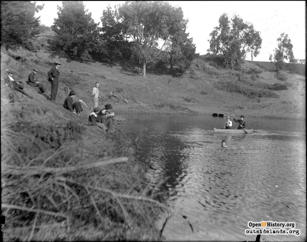 A group of men and boys boating in Pine Lake in 1903.