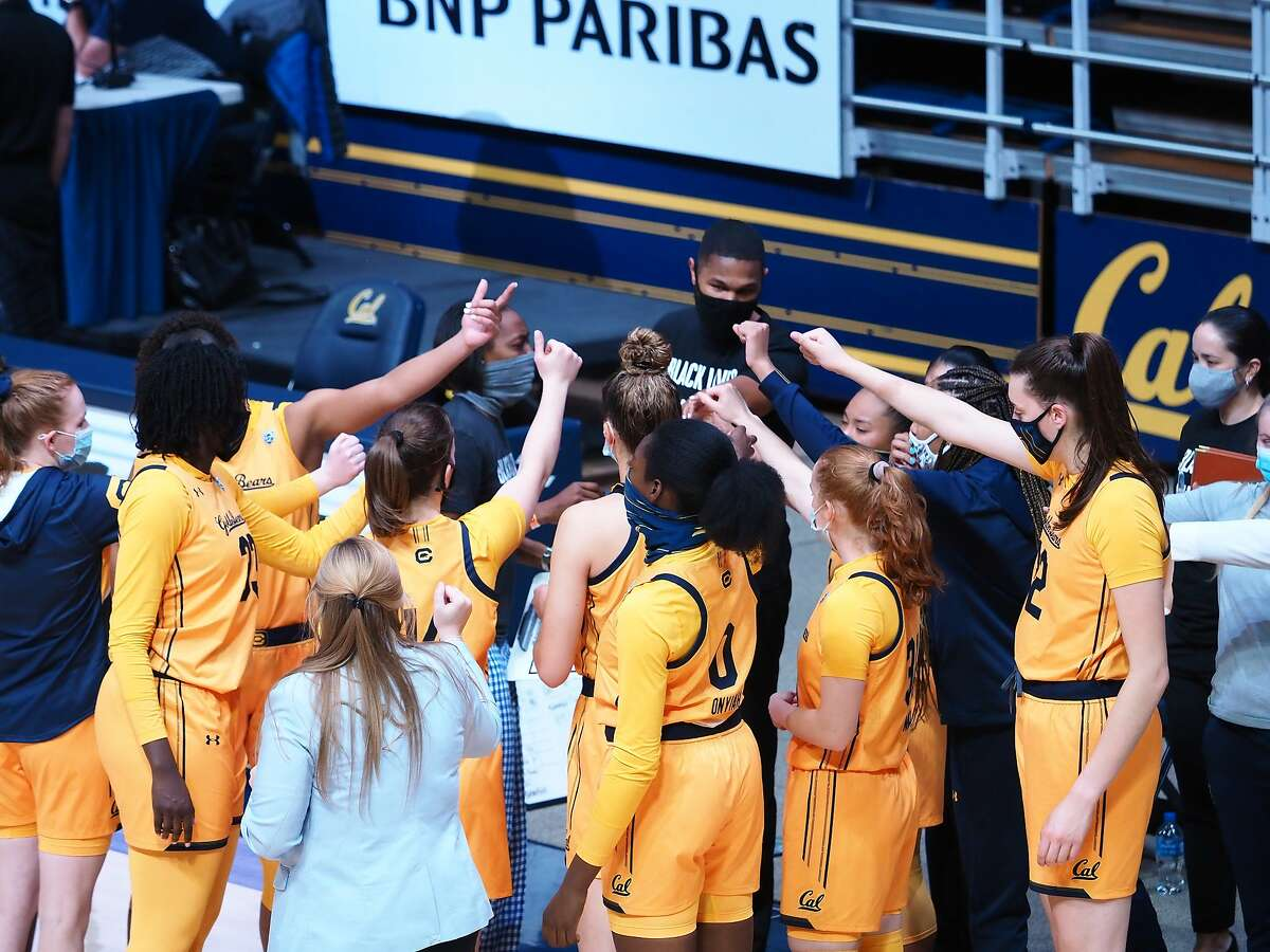 California women's basketball huddles before Sunday's non-conference matchup against CSU Bakersfield.