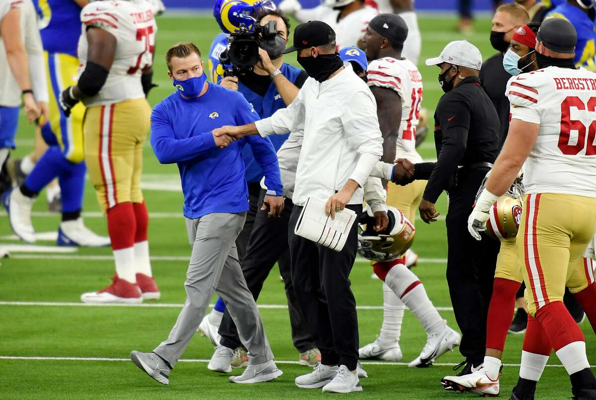 INGLEWOOD, CALIFORNIA - NOVEMBER 29: Head coach Sean McVay of the Los Angeles Rams shakes hands with head coach Kyle Shanahan of the San Francisco 49ers after the San Francisco 49ers defeated the Los Angeles Rams 23-20 at SoFi Stadium on November 29, 2020 in Inglewood, California. (Photo by Harry How/Getty Images)