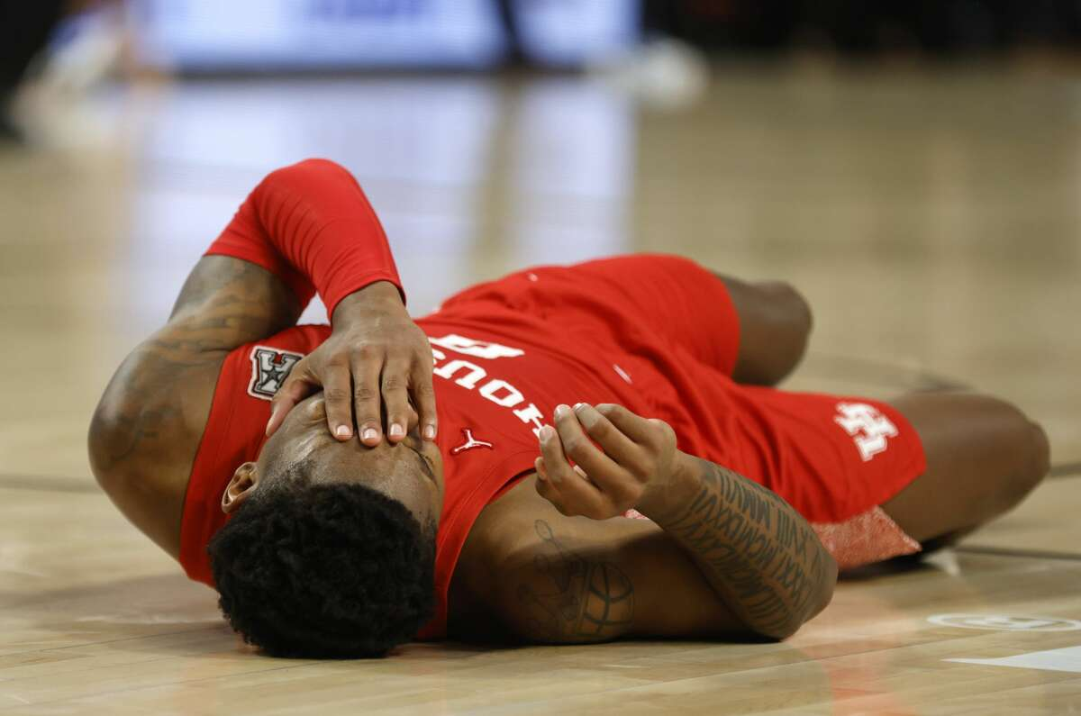 Houston guard Marcus Sasser (0) reacts after a collision with Texas Tech guard Mac McClung during the second half of an NCAA college basketball game, Sunday, Nov. 29, 2020, in Fort Worth, Texas. Sasser returned to the game. (AP Photo/Ron Jenkins)