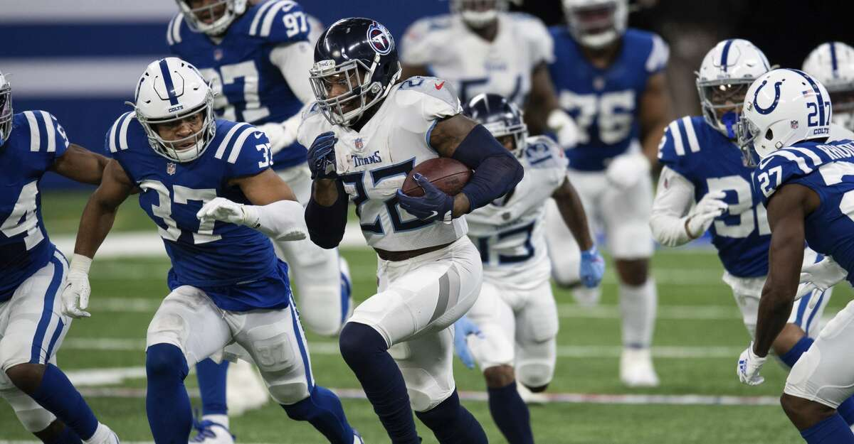 Tennessee Titans running back Derrick Henry (22) runs past Indianapolis Colts safety Khari Willis (37) for a big gain during an NFL football game on Sunday, Nov. 29, 2020, in Indianapolis. (AP Photo/Zach Bolinger)
