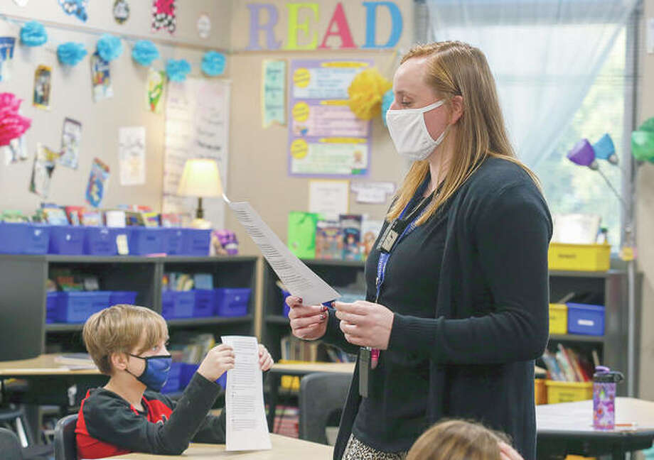 Teacher Hannah Marks, an Illinois College graduate, leads her class in an article at Lincoln-Douglas Elementary school in Quincy. Photo: Jake Shane | Herald-Whig (AP)
