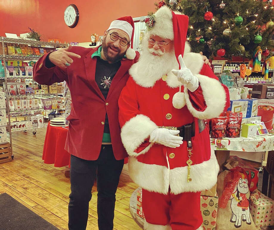 Red Fox Market owner Clinton Zimmerman stands with Santa before beginning visits in 2019. This year, new precautions have been put in place to make the visits safe amid the COVID-19 pandemic. Photo: Courtesy Photo