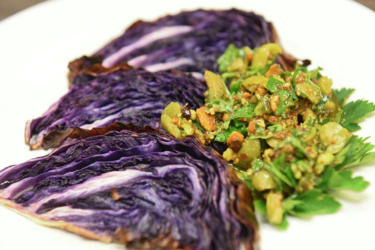 Roasted red cabbage with olive and pistachios made by Caroline Barrett at Different Drummer's Kitchen on Wednesday, Nov. 27, 2020 in Albany, N.Y. (Lori Van Buren/Times Union)