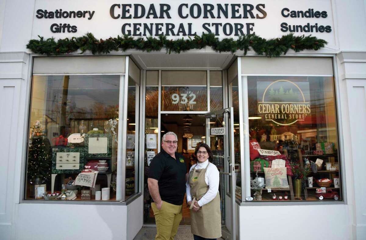 """Owners Michael and Liz Sweeney pose at the new Cedar Corners General Store in Stamford, Conn., on Tuesday, Nov.17, 2020. Located at 932 High Ridge Road, the store featuring gifts, provisions, candy, and clothing hopes to """"take a journey back to that simpler time and experience a blend of local, unique and fun gifts and accessories in an upbeat, old time turn-of-the-century charm."""""""