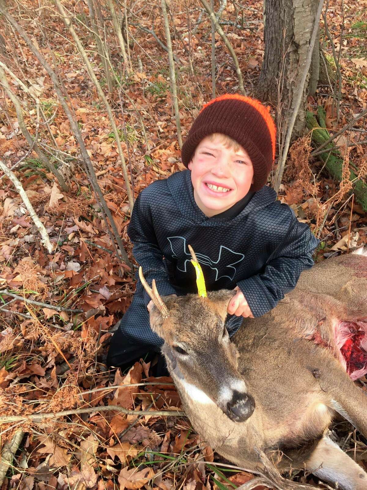Oliver Walker, 10, of Cass City, bagged his first buck, a Thumb 4-point, during the final weekend of the firearm deer season while using a .50 caliber muzzleloader. He was hunting with his grandfather, Bob Walker, of Kingston. (Photo by Ryan Walker)