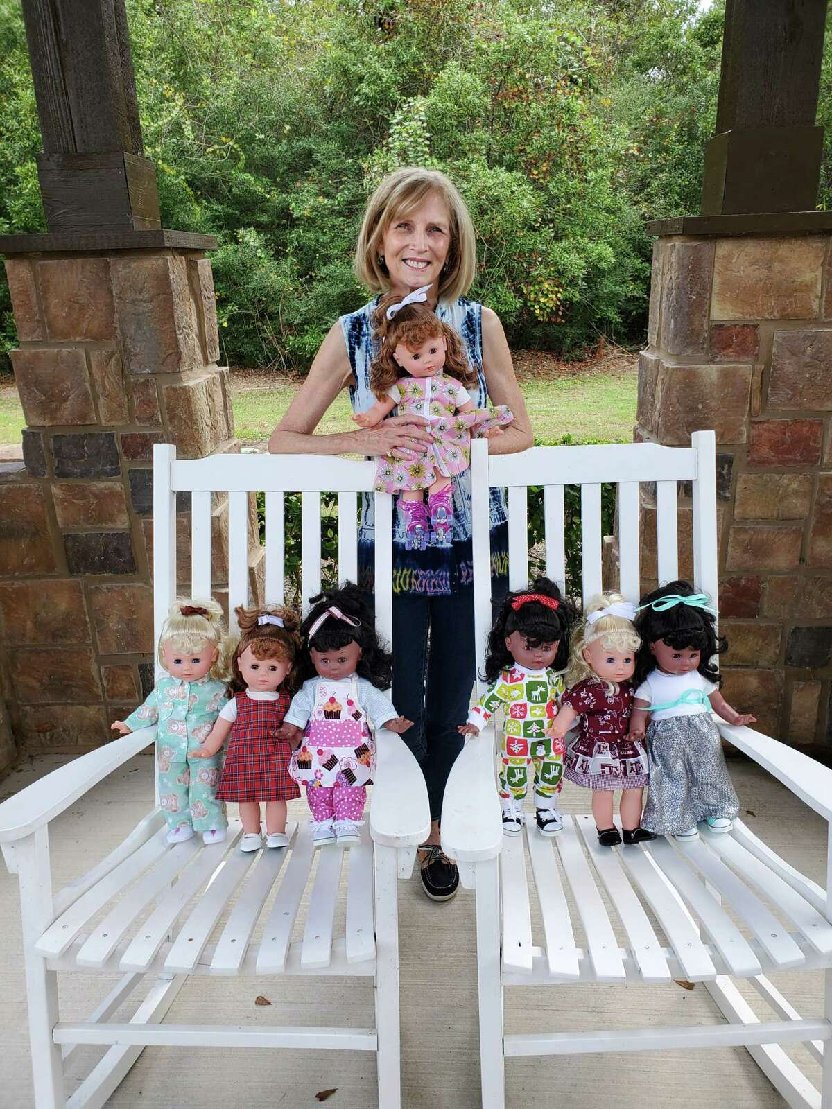 Ruth Parrish shows off the dolls she dressed for this year's event.