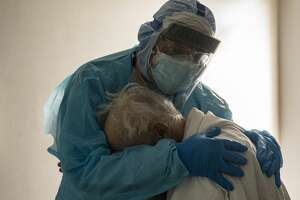 Featured Image: Dr. Joseph Varon hugs and comforts a patient in the COVID-19 intensive care unit (ICU) during Thanksgiving at the United Memorial Medical Center on November 26, 2020 in Houston, Texas. According to reports, Texas has reached over 1,220,000 cases, including over 21,500 deaths. (Photo by Go Nakamura/Getty Images)