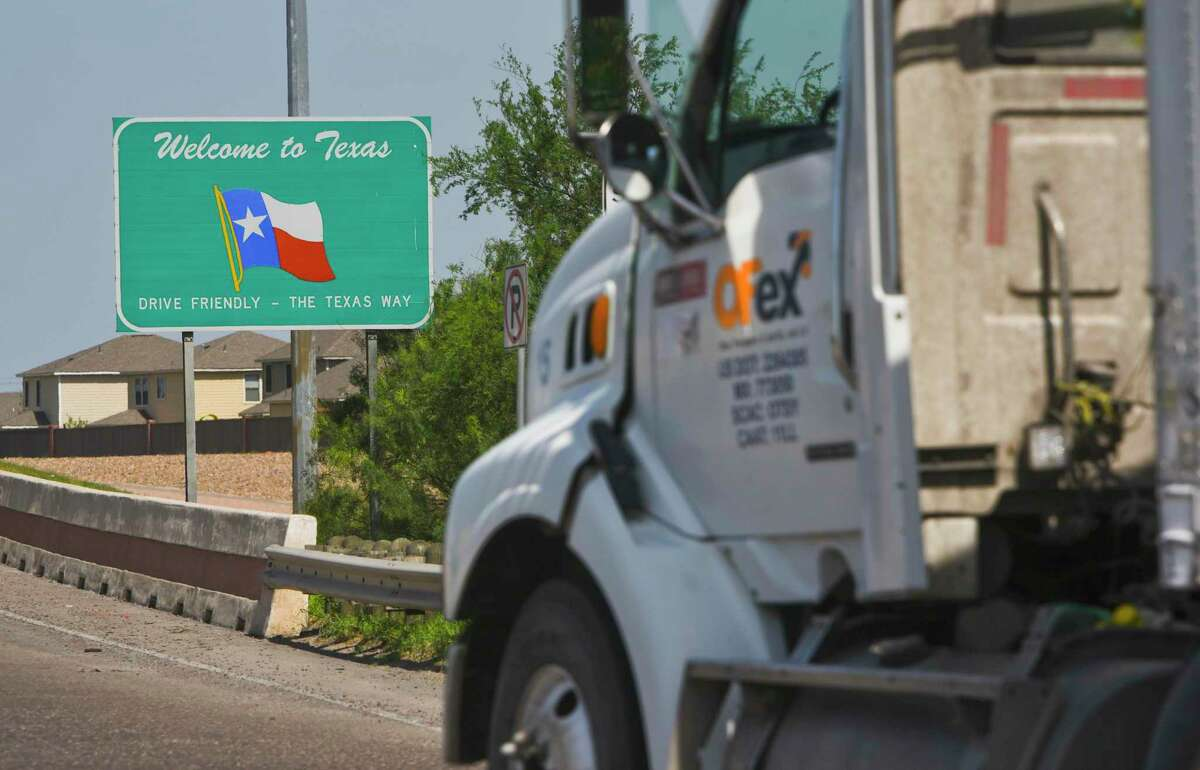 This file photo shows Tractor trailers crossing the World Trade Bridge into the United States from Mexico. The impact of the coronavirus on Mexico's economy is hurting local economies on the Texas border.