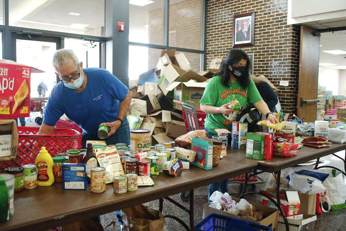 Felix Marrero, Cindy Navarro and San Jacinto College employee Brianna Kyles sort donations.