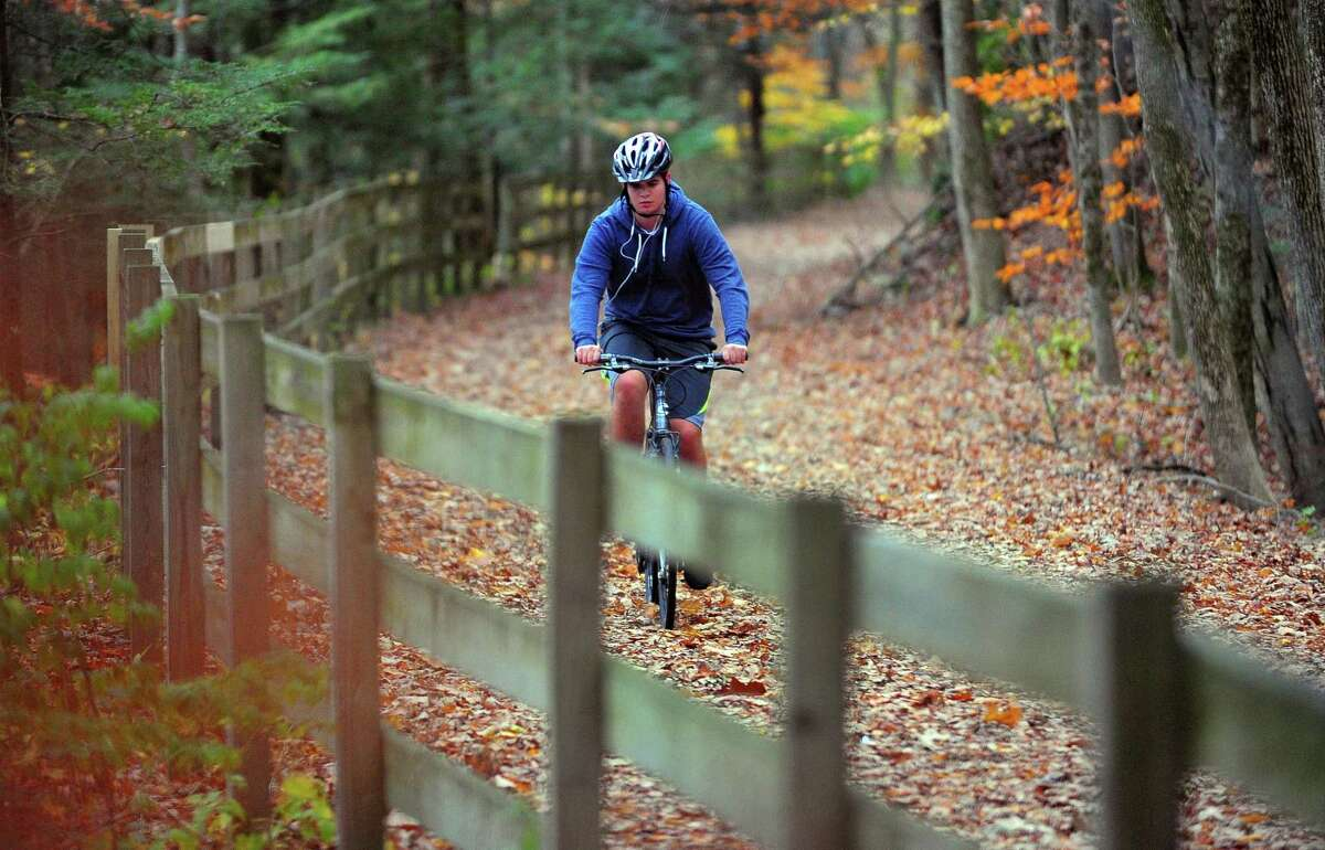 A bicyclist rides along the Housatonic Railway Rails to Trails Pequonnock Valley Greenway in Trumbull in 2016.