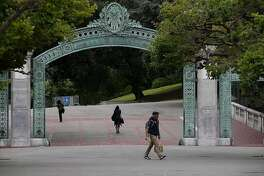 Pedestrians walk by Sather Gate on the UC Berkeley campus on May 22, 2014 in Berkeley, California. The university will remove the names from two halls due to controversial legacies. (Justin Sullivan/Getty Images/TNS)