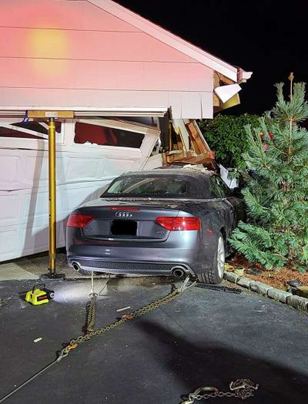 A vehicle slammed into a garage attached to a home in North Stamford.