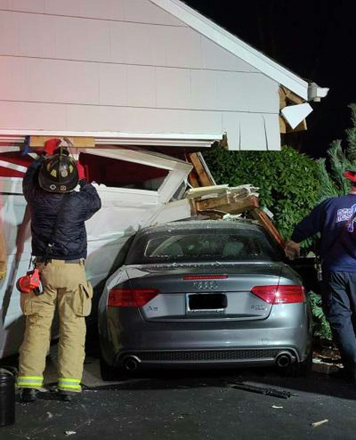 The roof of a garage attached to a home in North Stamford needed to be shored up after a car slammed into it.