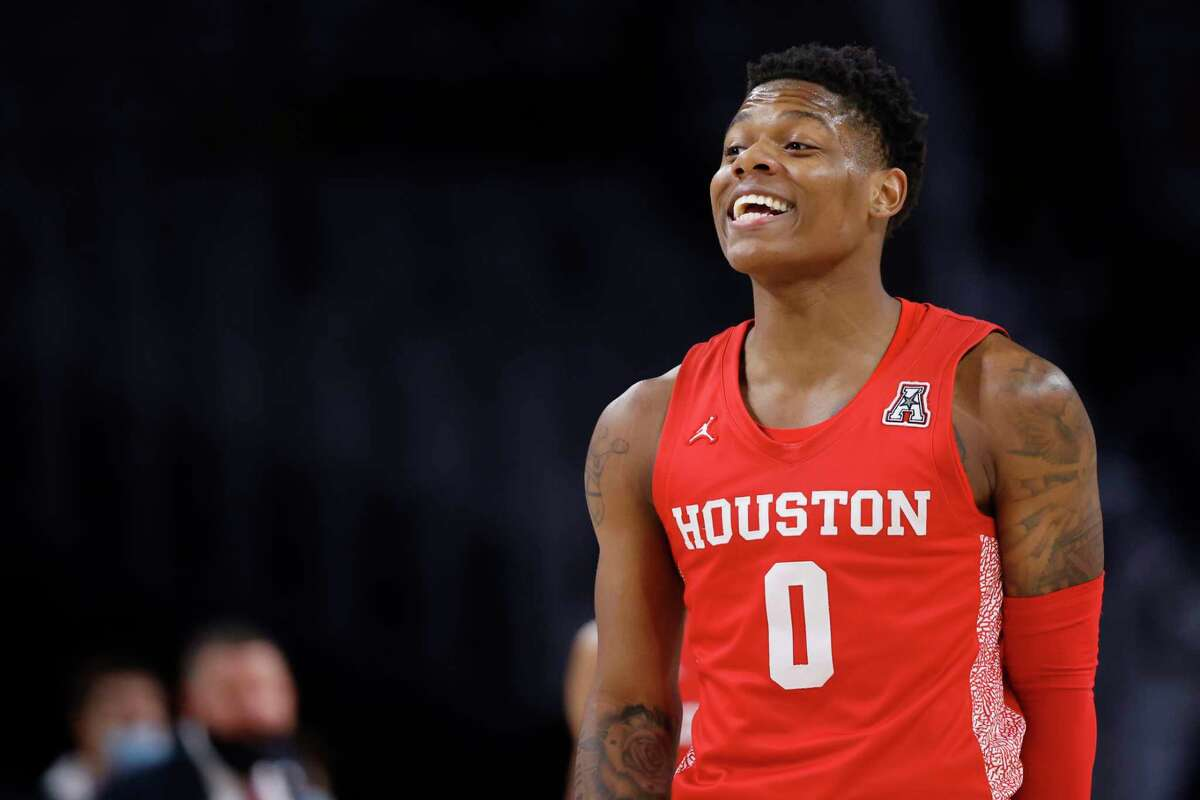 Houston guard Marcus Sasser (0) reacts against Texas Tech during the first half of an NCAA college basketball game, Sunday, Nov. 29, 2020 in Fort Worth, Texas. (AP Photo/Ron Jenkins)