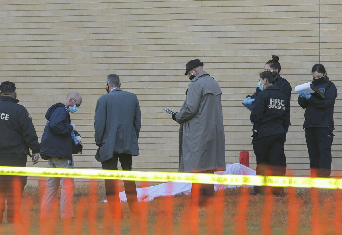 Houston Police officers and homicide detectives investigate the scene where a homeless woman was found dead outside the Science and Engineering Classroom Building at the University of Houston on Monday, Nov. 30, 2020, in Houston.