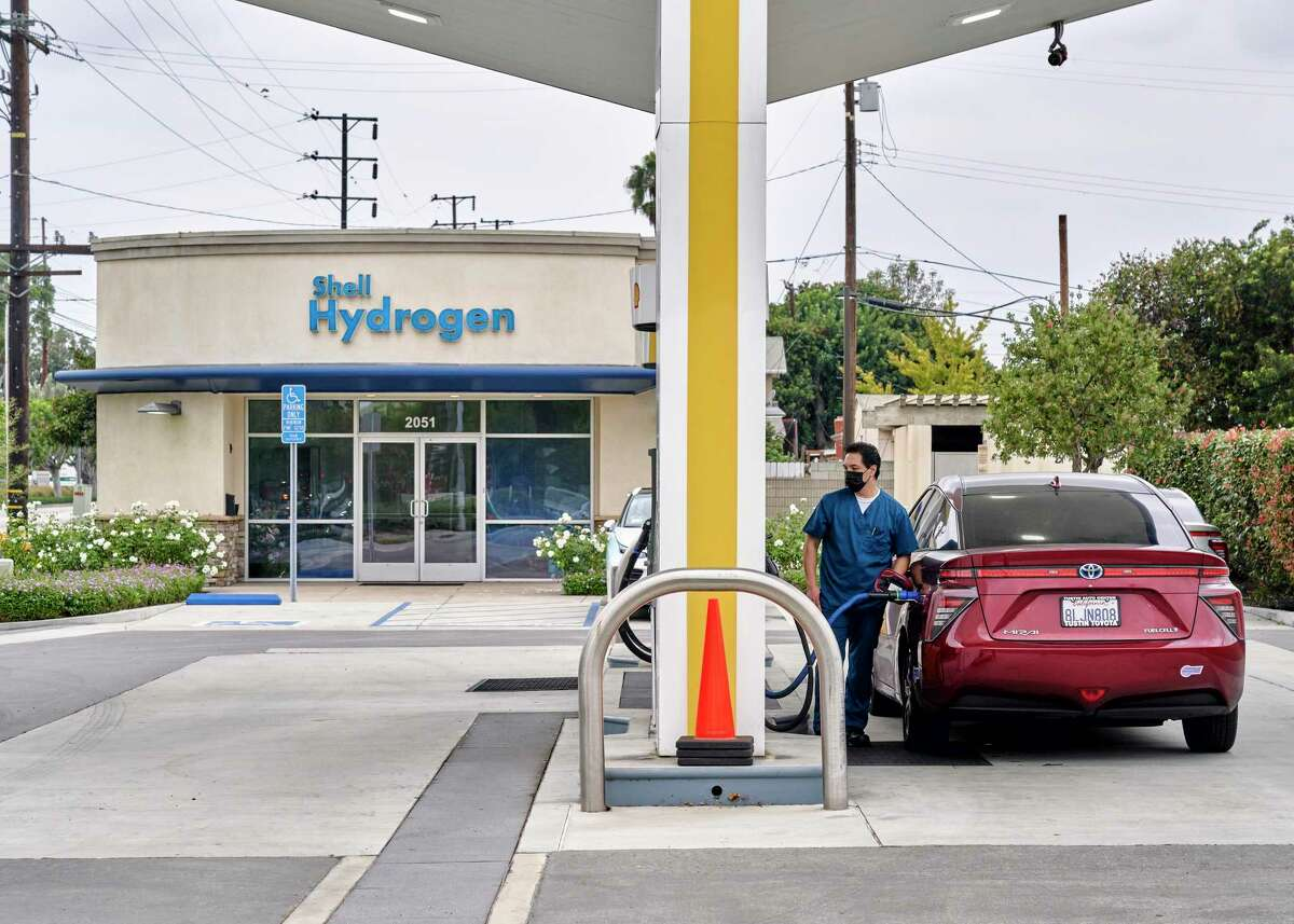 A motorist fills their Toyota Mirai, a hydrogen-powered car, at a gas station in Torrance, Calif., Oct. 22, 2020. The fuel could play an important role in fighting climate change, but it has been slow to gain traction because of high costs. (Philip Cheung/The New York Times)