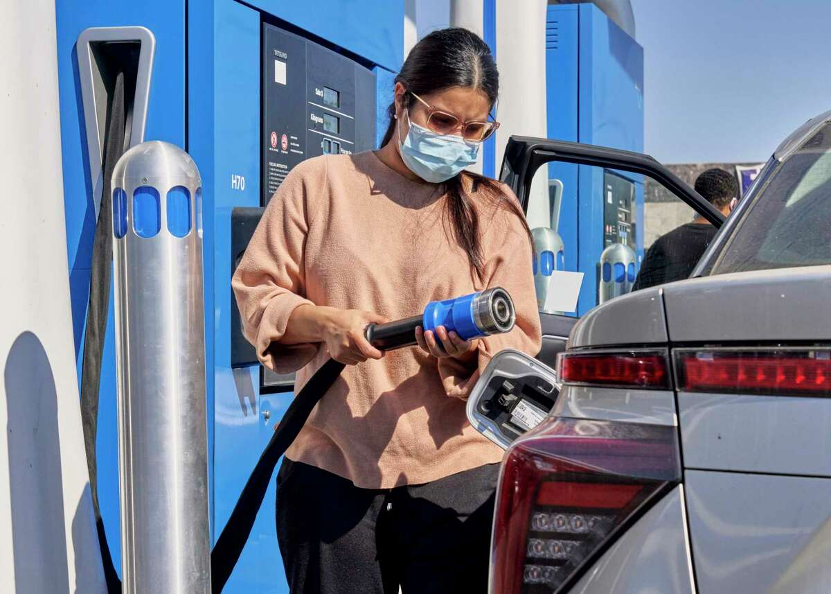 A motorist fills their Toyota Mirai, a hydrogen-powered car, at a gas station in Fountain Valley, Calif., Oct. 14, 2020. The fuel could play an important role in fighting climate change, but it has been slow to gain traction because of high costs. (Philip Cheung/The New York Times)