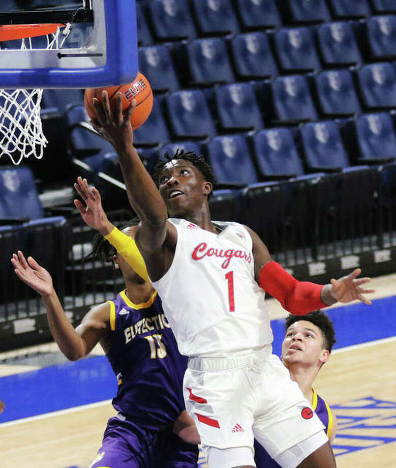 SIUE's Mike Adewunmi (1) drives past two UHSP defenders to score at the rim during the Cougars' win Saturday night in the Billiken Classic at Chaifetz Arena in St. Louis. Adewunmi, a senior, led SIUE in scoring at 13.0 points per game in three games last week at Chaifetz. Photo: Greg Shashack / The Telegraph