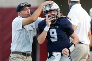 College Park quarterback Hank Hudson threw for 323 yards and three touchdowns against The Woodlands on Friday.