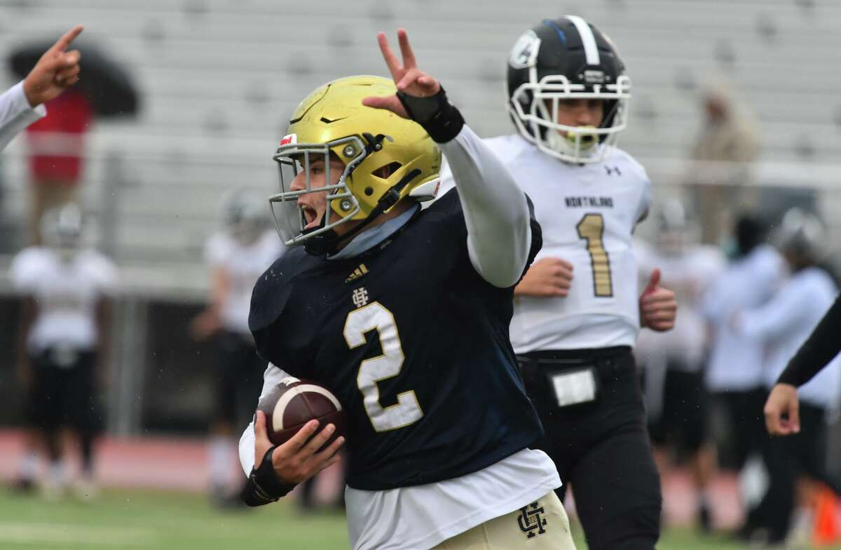 Holy Cross' Anthony Rodriguez yells after scoring a first quarter touchdown against Houston Northland Chrstian during their TAPPS playoff game Saturday afternoon at the Wheatley Heights Sports Complex.