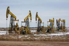 Oil pumping jacks in a Rosneft Oil Co. oil field near Sokolovka village in the Udmurt Republic, Russia, on Nov. 20, 2020. The flaring coronavirus outbreak will be a key issue for OPEC+ when it meets at the end of the month to decide on whether to delay a planned easing of cuts early next year. MUST CREDIT: Bloomberg photo by Andrey Rudakov