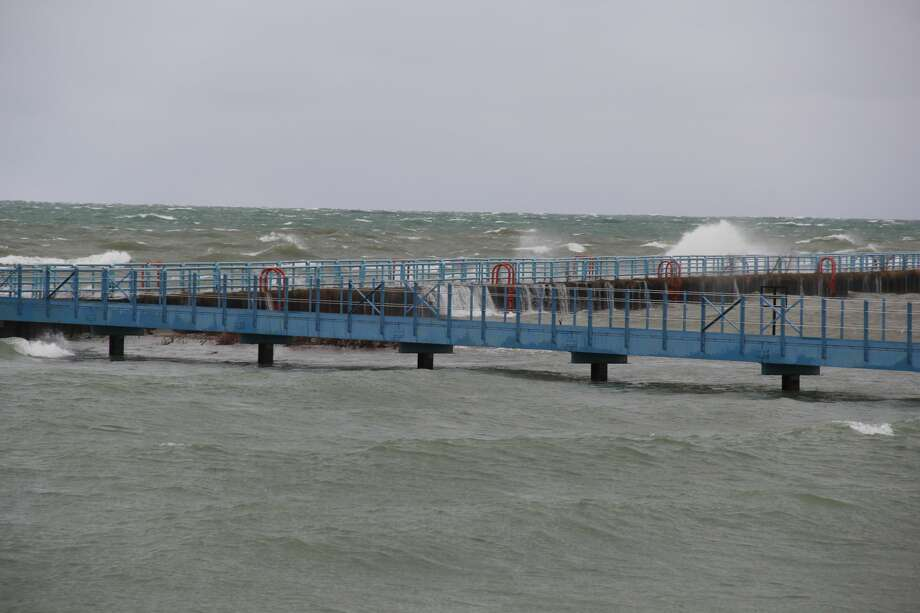 High winds off of Lake Huron pushed many waves onto the shores of Port Austin and its breakwall on Monday morning. A lakeshore flooding warning is in effect until noon on Tuesday, which may see winds of up to 35 mph or more. Photo: Robert Creenan/Huron Daily Tribune