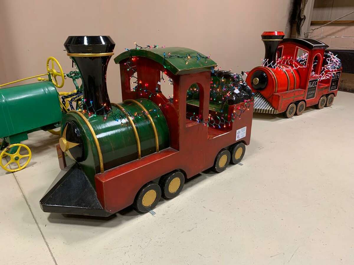 St. John Paul the Great Academy in Torrington held its tours and drive-through Christmas event at Action Wildlife in Goshen this weekend. The event continues Dec. 4-6. Above, a holiday train dispaly in the display building.