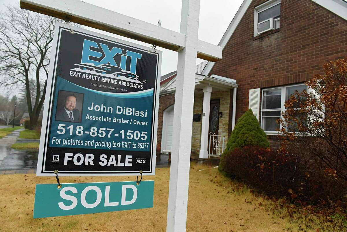 A sold sign is seen hanging from a for sale realty sign on Monday, Nov. 30, 2020 in Albany, N.Y. (Lori Van Buren/Times Union)