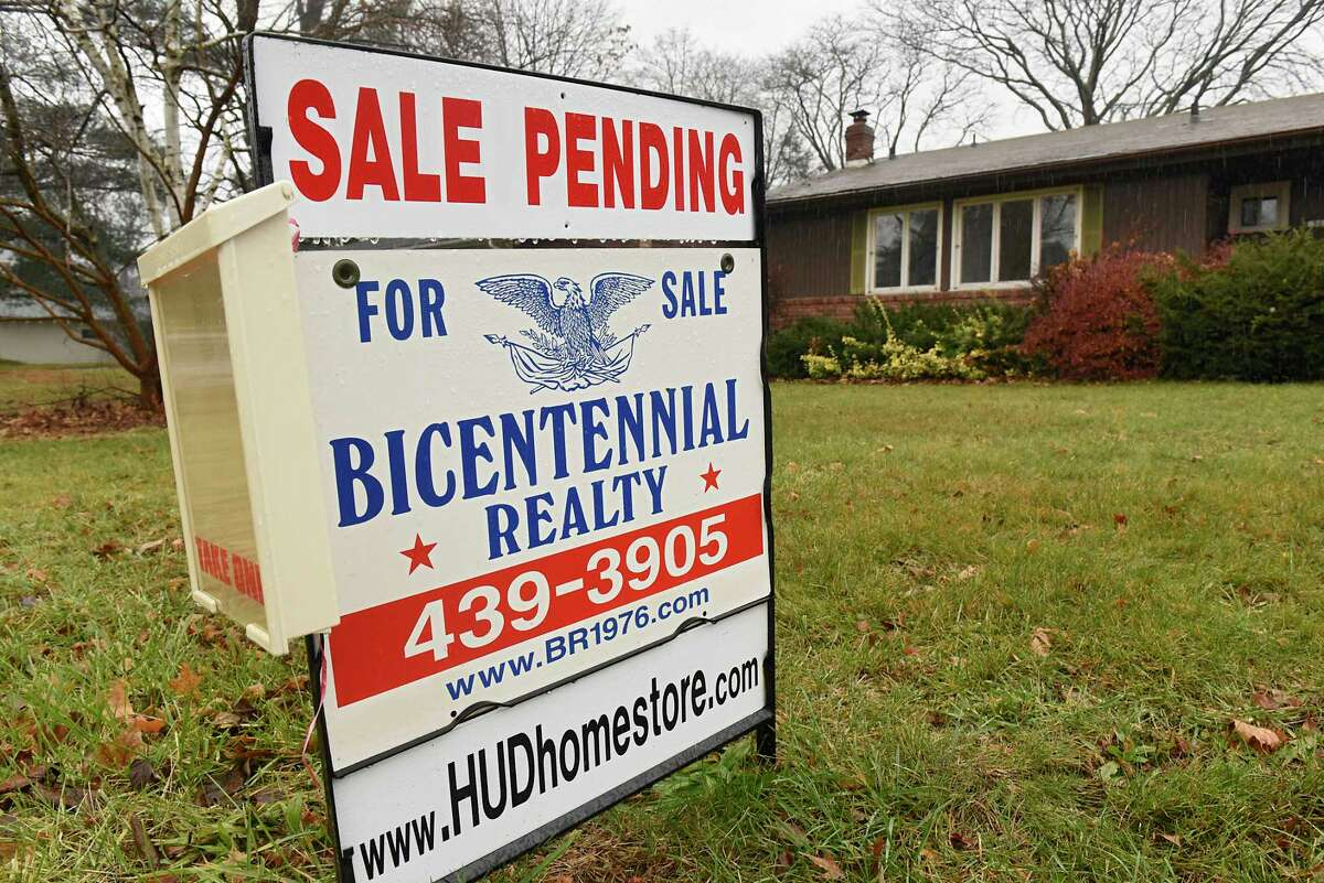A sale pending realty sign is seen in front of a home on Monday, Nov. 30, 2020 in Albany, N.Y. (Lori Van Buren/Times Union)