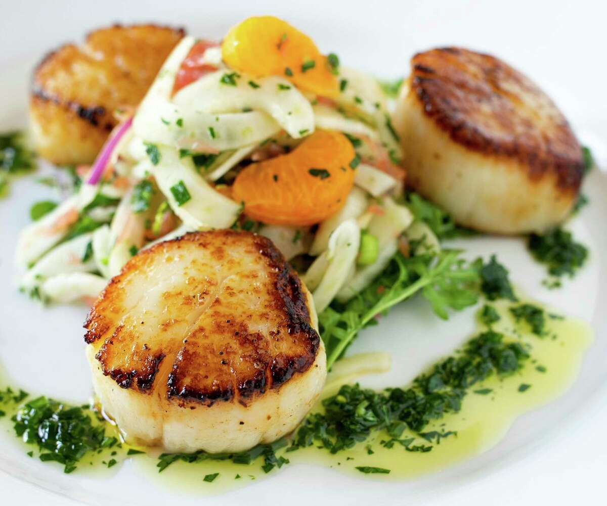 Dishes such as pan-roasted scallops with citrus and fennel salad with herb pistou will be part of the menu at Bar Loretta, a new bar and restaurant concept coming to Southtown in February 2021.