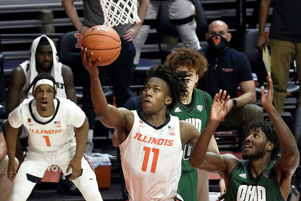 Illinois' Ayo Dosunmu (11) goes up for a shot past Ohio's Lunden McDay during the second half of a game Friday in Champaign.