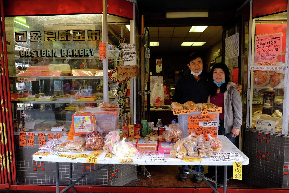 Orlando and Elaine Kuan, owners of Eastern Bakery in San Francisco, sell their famous mooncakes and pastries outside their storefront on Nov. 8, 2020.