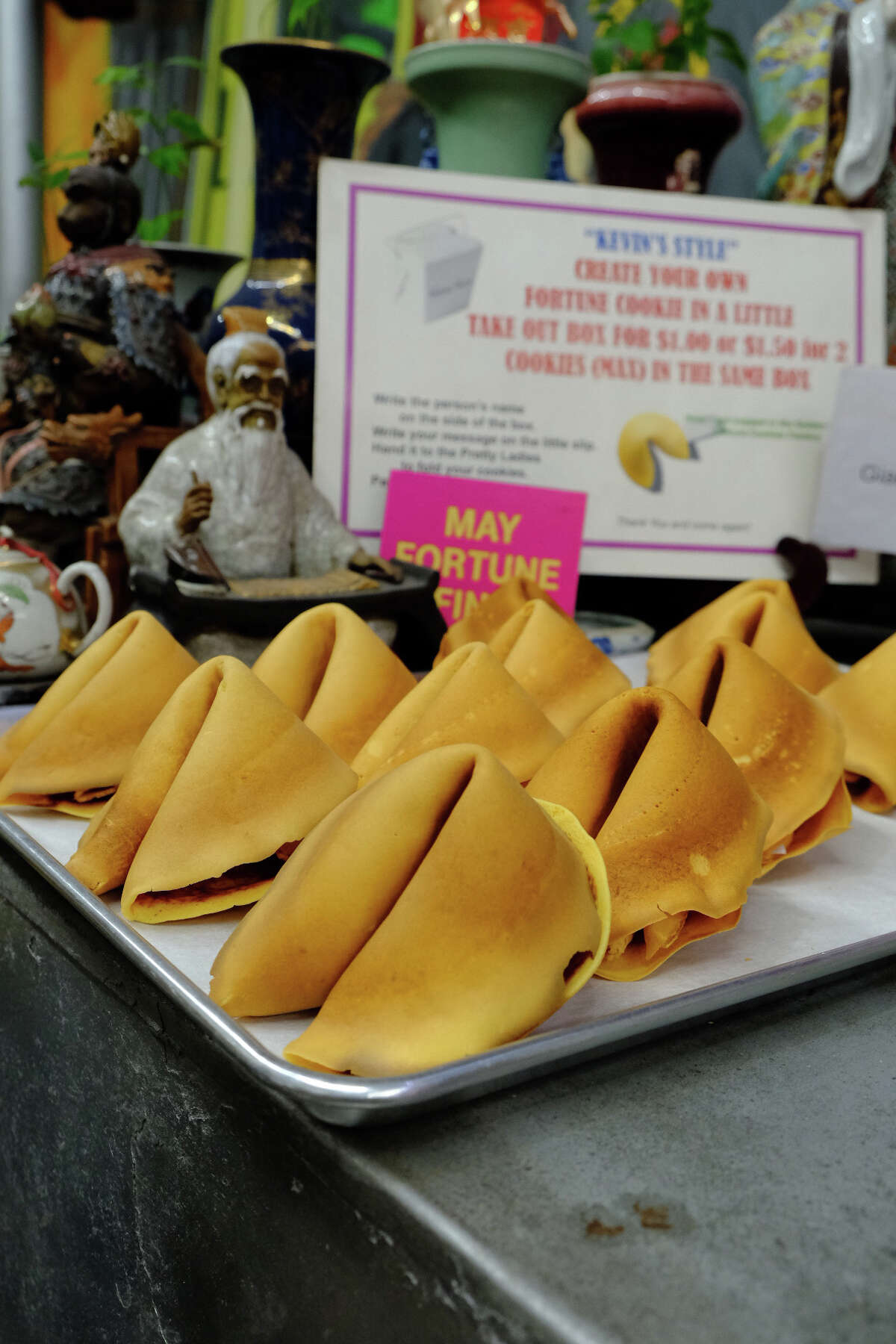 A display of large fortune cookies sits on one of the machines at the Golden Gate Fortune Cookie Factory on Nov. 8, 2020.