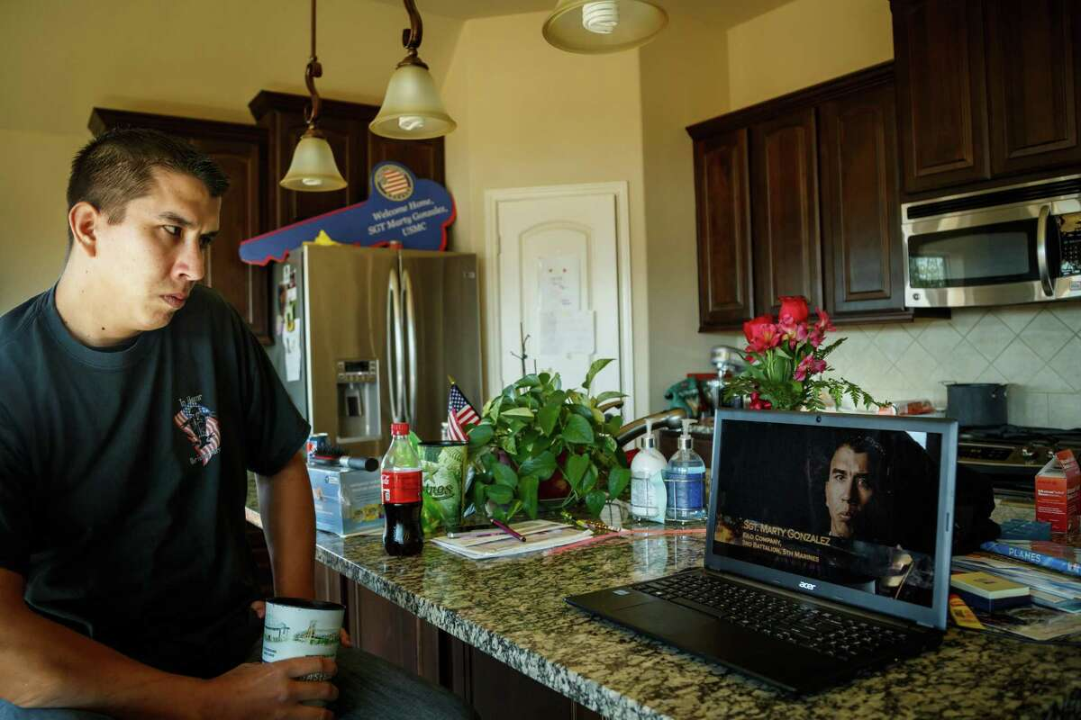 Retired Marine Sgt. Marty Gonzalez watches a recording of himself on the Military Channel's Ultimate Warfare Episode: