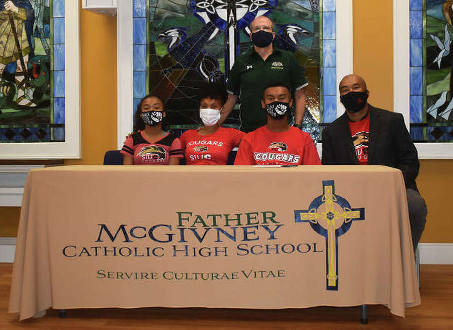 Father McGivney senior Tyler Guthrie, seated second from the right, will run cross country and track and field at SIUE. He is joined in the picture by his family and FMCHS coach Jim Helton. Photo: Matt Kamp|The Intelligencer