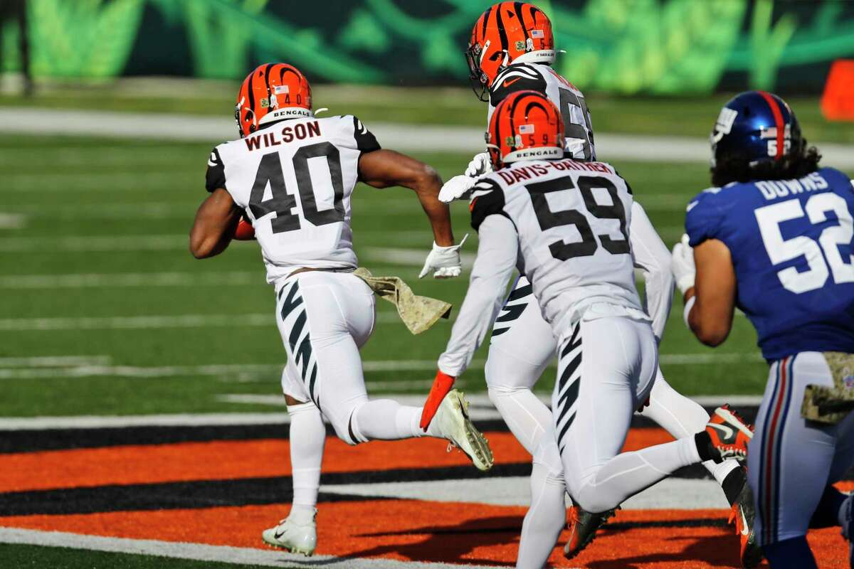 UH alum Brandon Wilson (40) set a Bengals franchise record with a 103-yard kickoff return for a touchdown Sunday against the Giants.