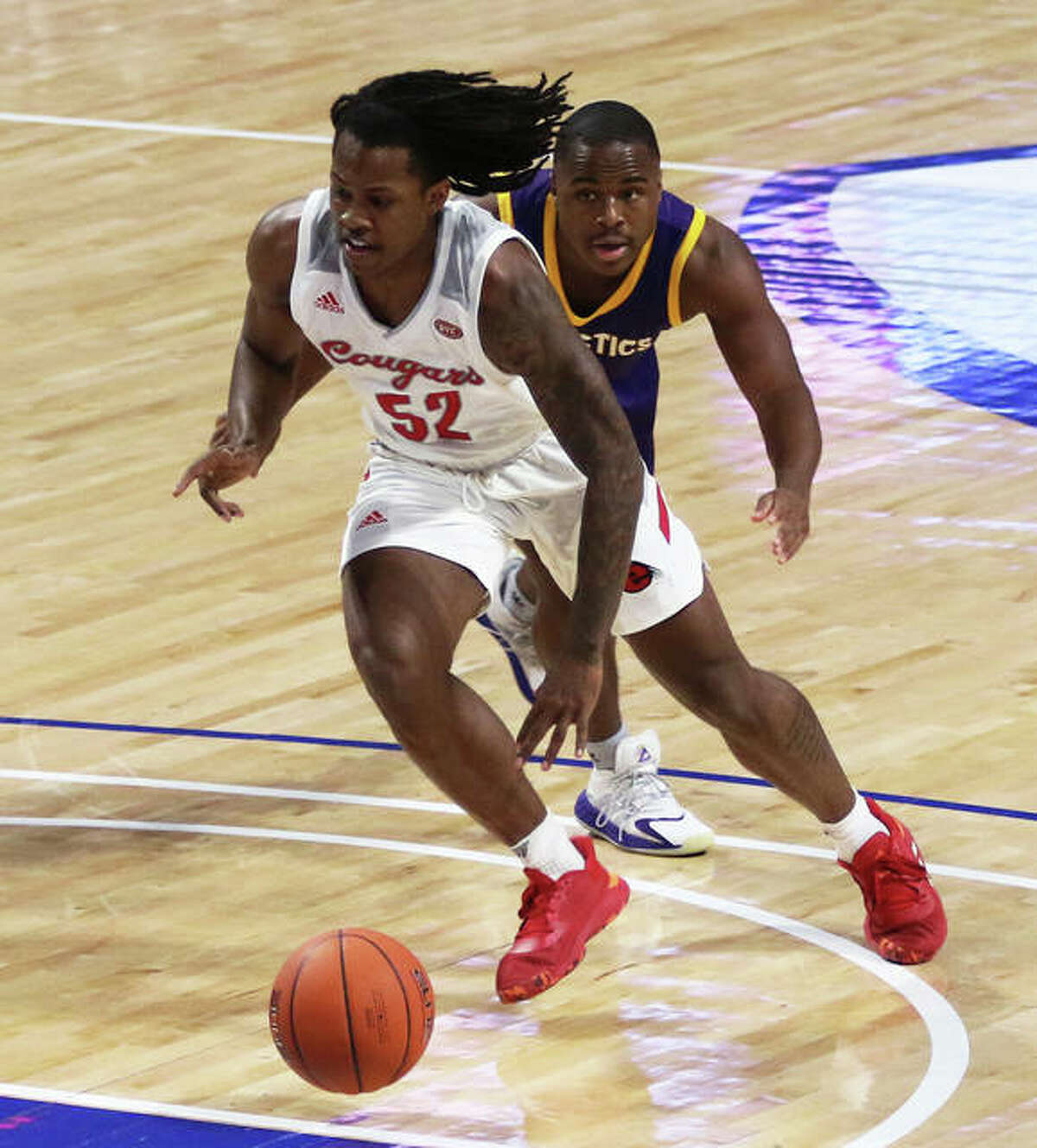 SIUE's Iziah James (52) drives the lane Saturday night against UHSP at Chaifetz Arena in St. Louis.