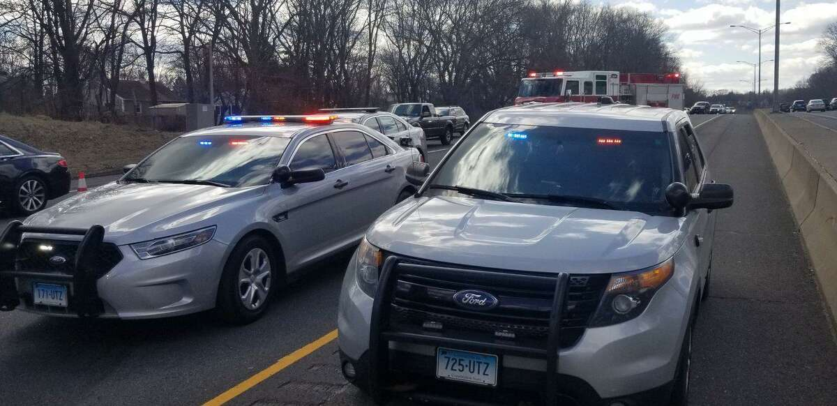Two young men were arrested Sunday after police say they crashed a stolen car on I-84 in Danbury.