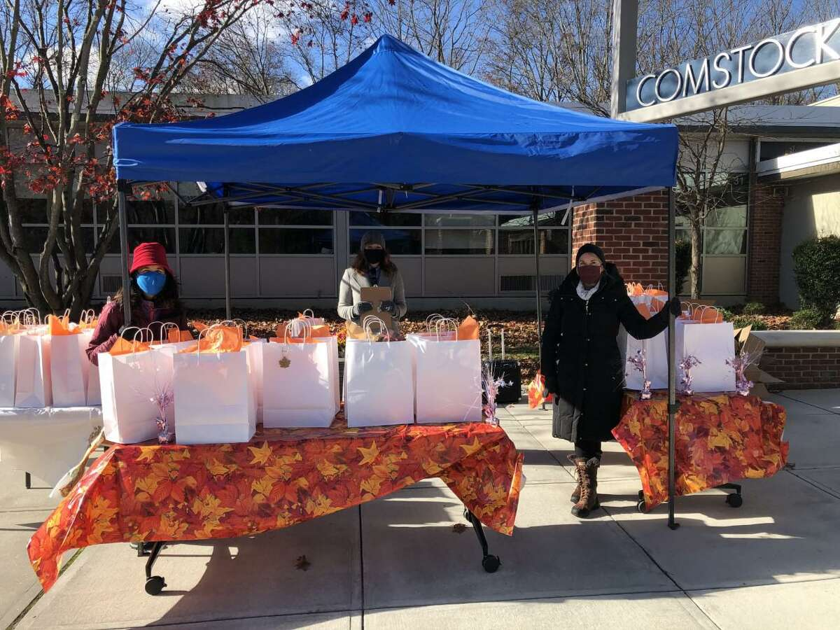 The Wilton Woman's Club provided Thanksgiving meals to 155 older adults at a drive-thru event on Nov. 18. Standing by to hand them out at Comstock Community Center are, from left, Maria Wilcox of the woman's club; Stephanie Rowe of Wilton Social Services; and Liz Salguero of the woman's club.